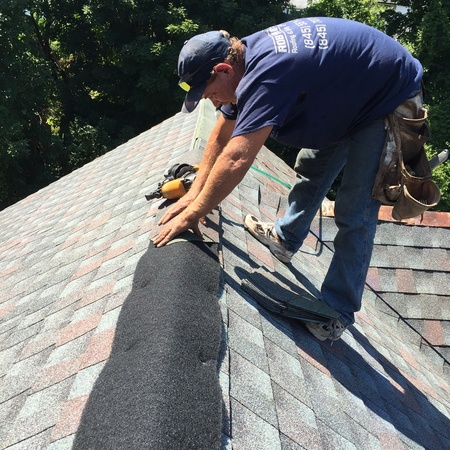 Roofer from Rob Sherlock Roofing in Wurtsboro, NY applying new shingles to a residential home